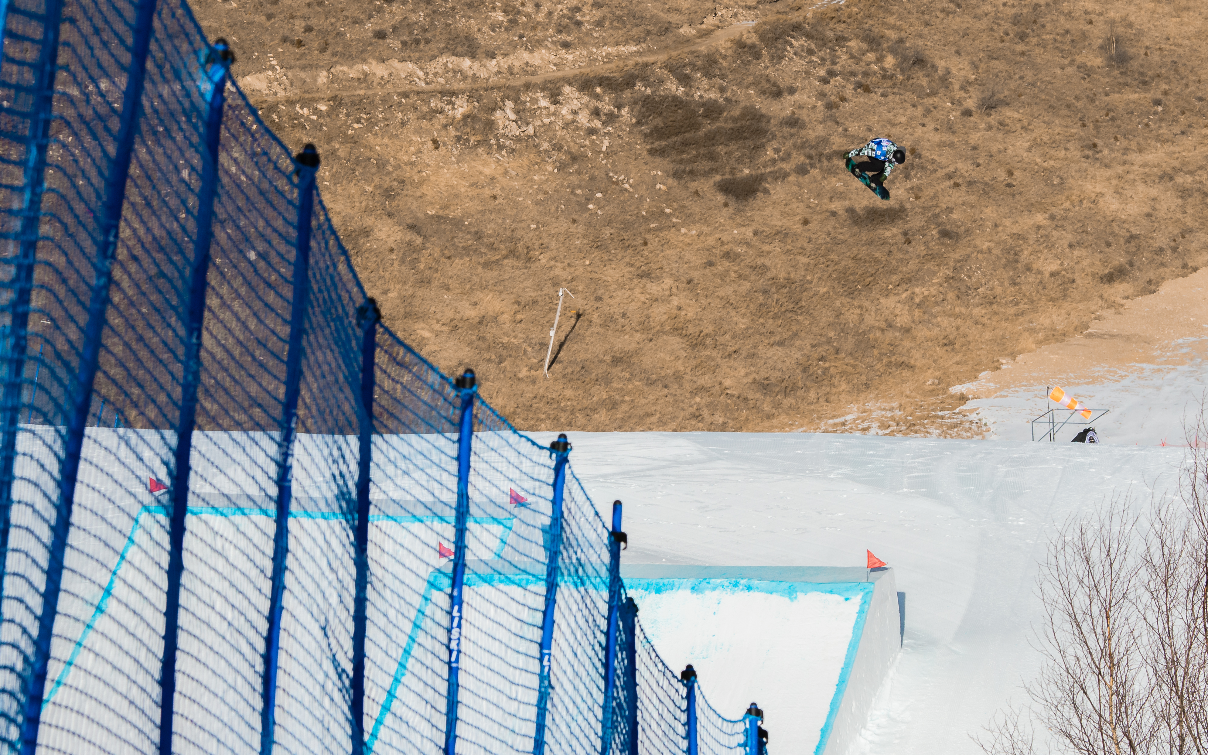 Hiroaki Kunitake cab-12 over the first kicker during the  FIS World Cup Secret Garden slopestyle event in China.