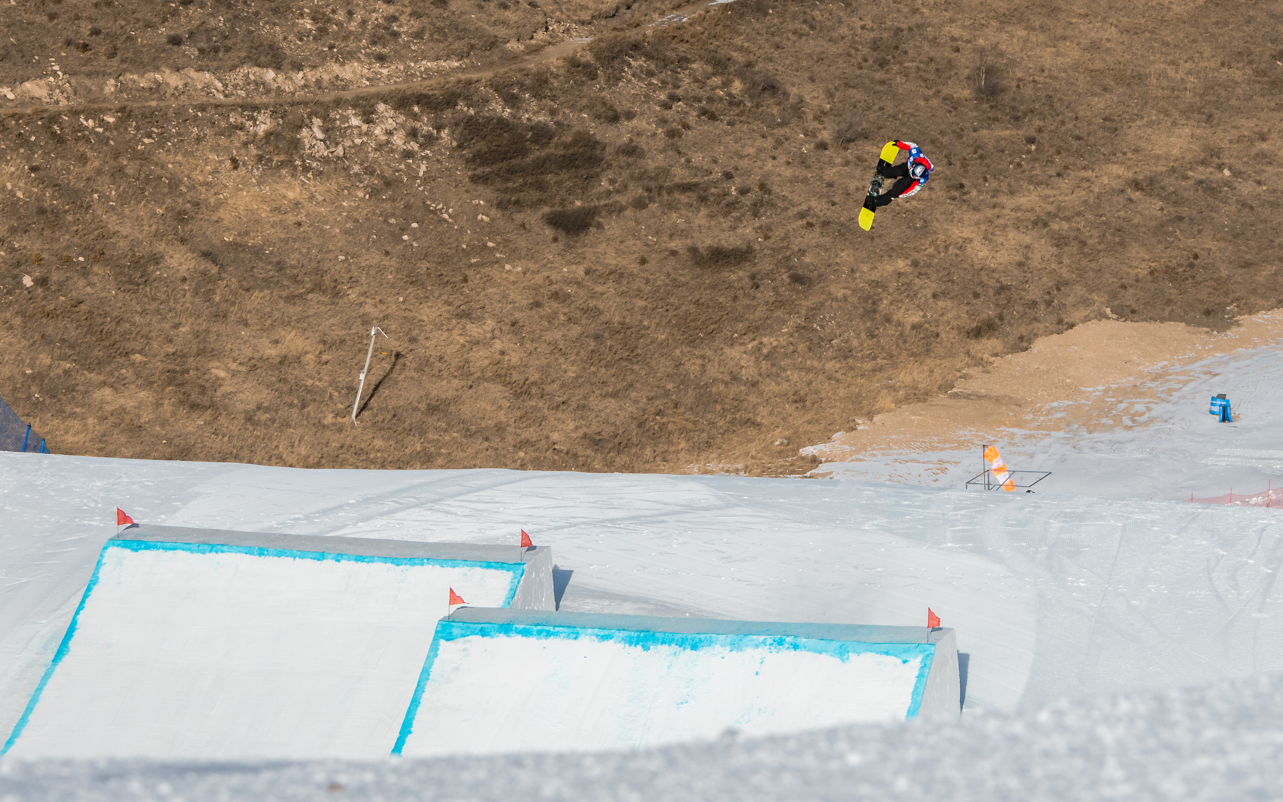 Takeru Otsuka front double 1440 tail at the FIS Secret Garden slopestyle World Cup event in China.