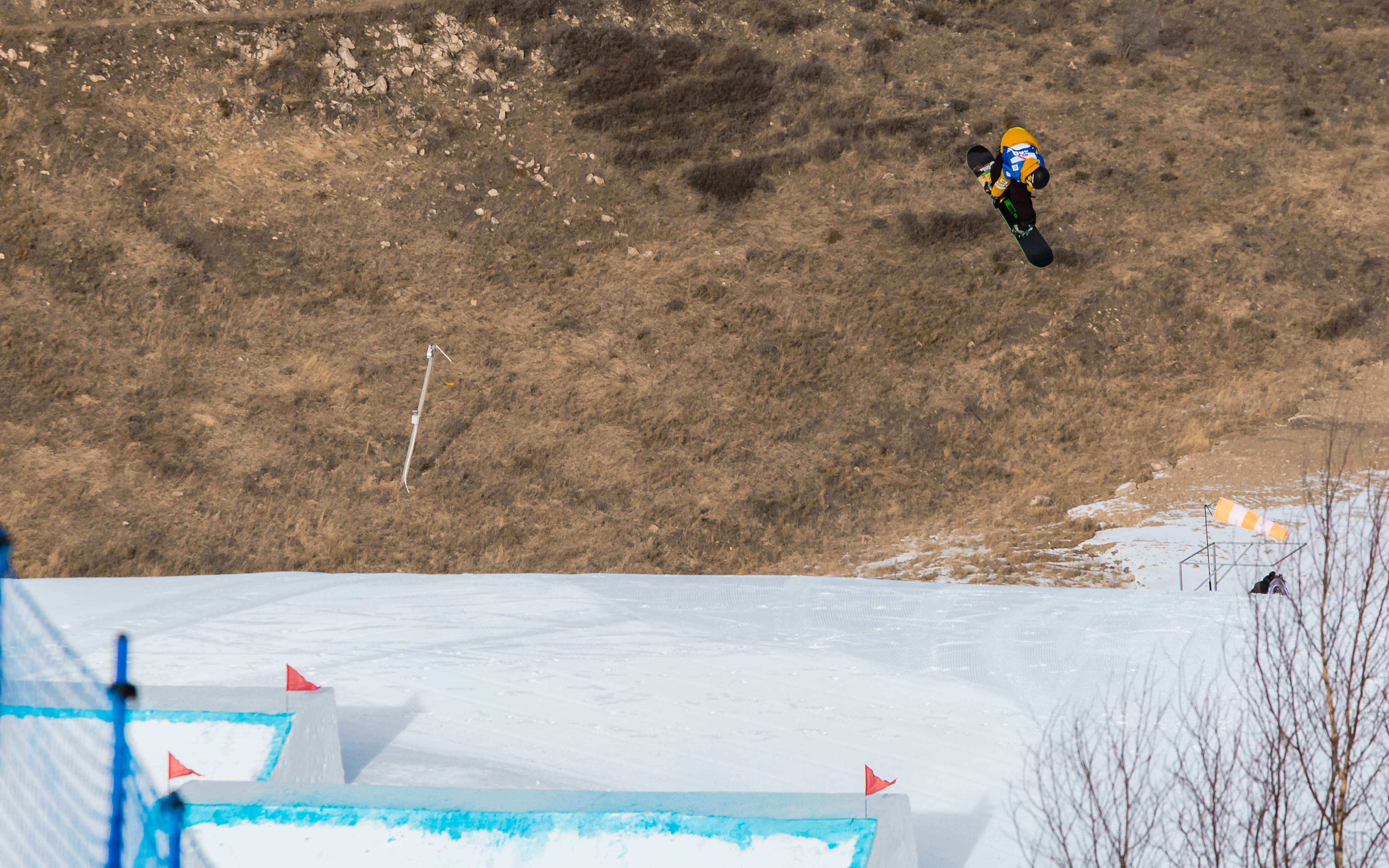 Yuri Okubo cab-12 over the first kicker during the  FIS World Cup Secret Garden slopestyle event in China.
