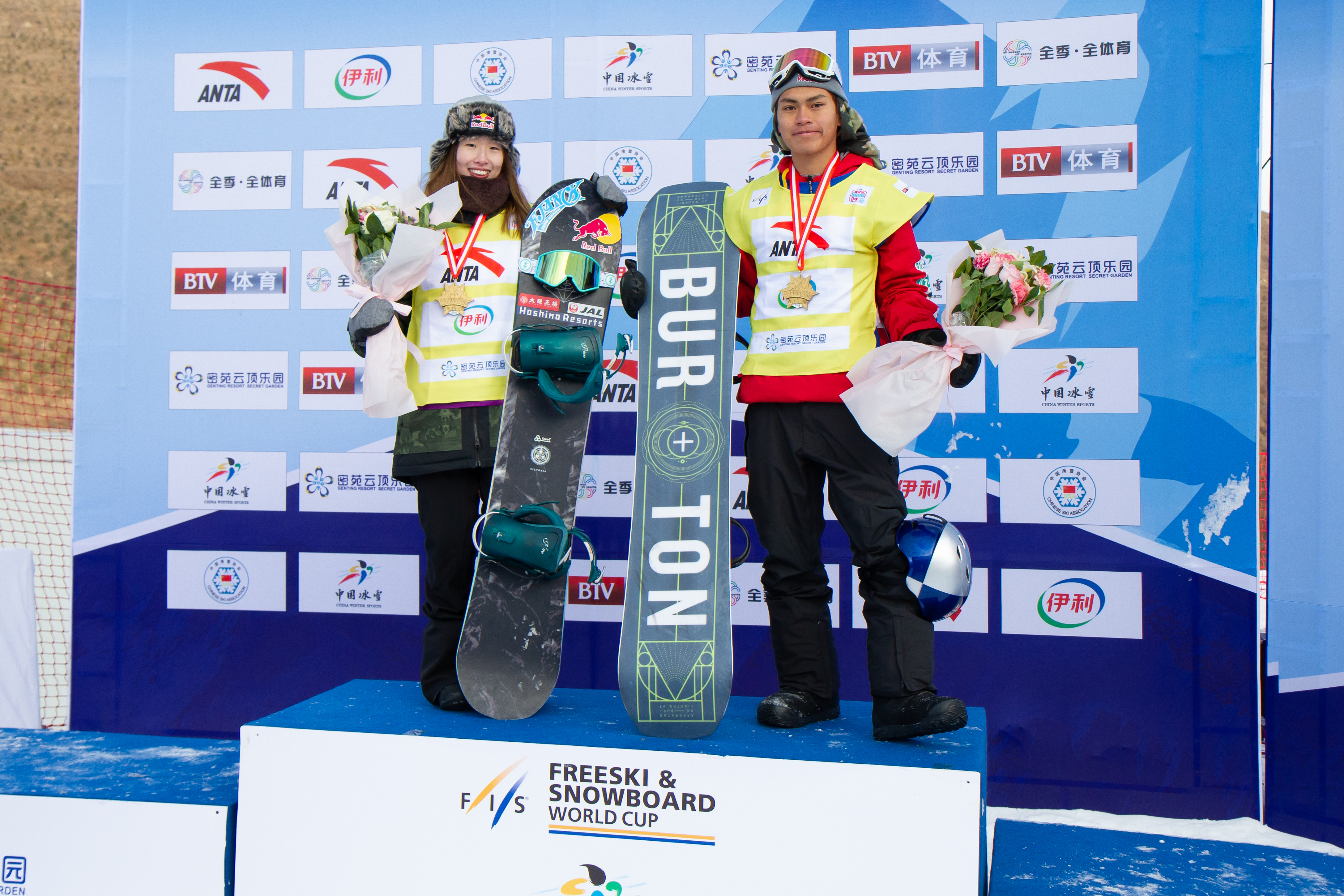 Miyabi Onitsuka and Takeru Otsuka take the yellow jersies after the  FIS World Cup Secret Garden slopestyle event in China.