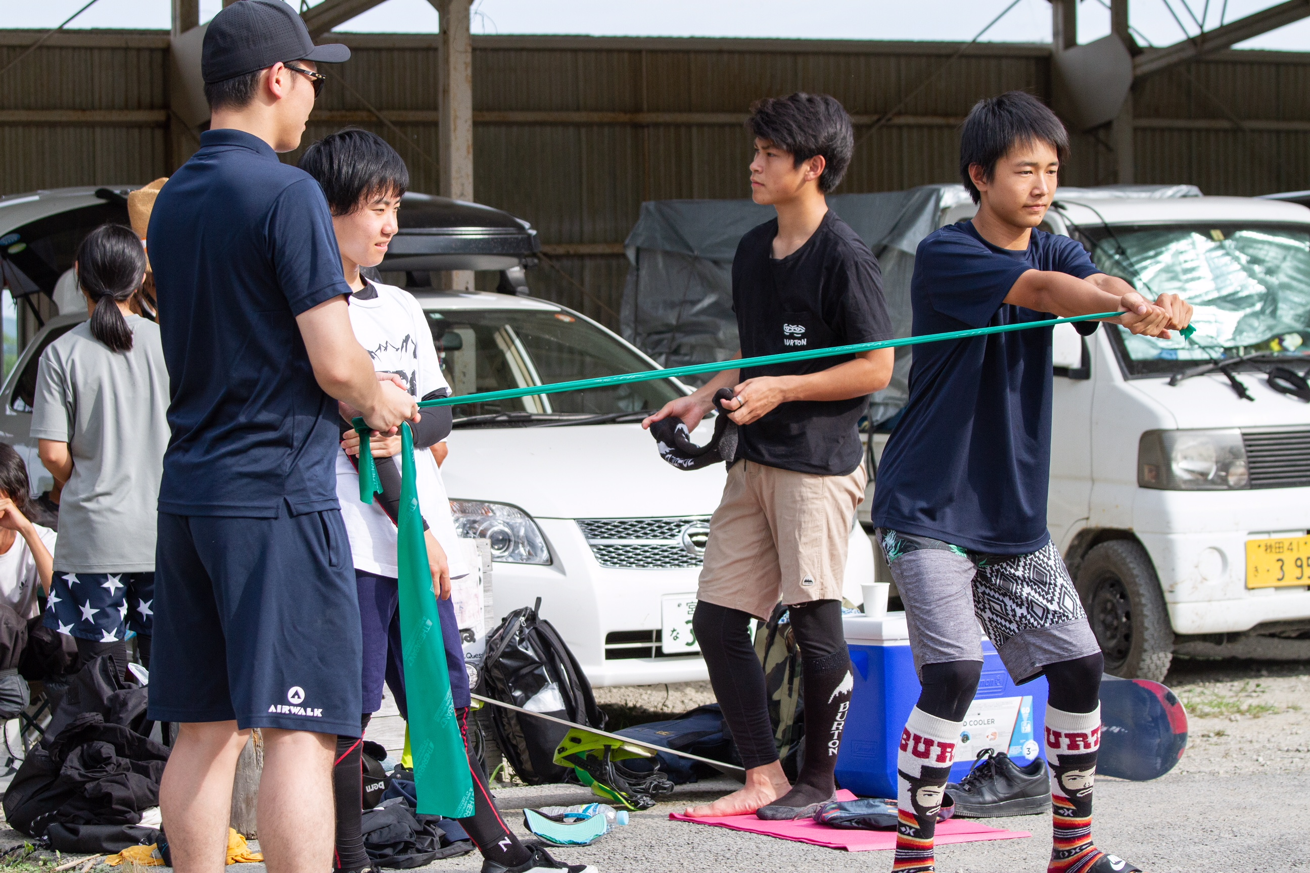 Aoto Kawakami warming up with Kenjiro trainer at national team training summer camp at Tohoku Quest.